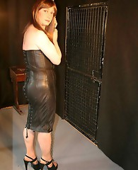 Sexy Lucimay puts on a leather dress and then gets tied up in the dungeon.