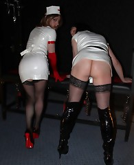 Slutty TGirl Kirsty is dressed as a nurse and having some sexy with with a horny FemDom.