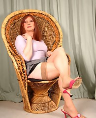 Sexy TGirl Lucimay hitches up her mini skirt and grabs her thick cock.
