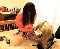 Kirsty is used and abused by her Mistress and has her ass fingered.