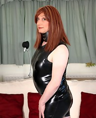Lucimay is wearing her sexy PVC outfit and taking a mouth full of hard cock.