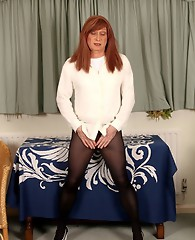 Lucimay is wearing some gorgeous opaque tights and show loves to show off those long legs of hers.