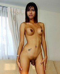 Gorgeous asian shemale shows her cock surprise to you