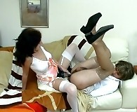 Horny sissy guy getting his buns spread wide with huge strap-on of lewd gal