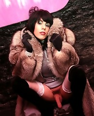 Zoe spreads wide on a fur coat