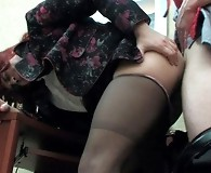 Sissified co-worker in a female suit getting his pantyhose creamed at work