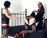 This little sissy slut gets dressed up by Strapon Jane