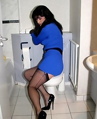Sexy TGirl Yvette is posing in her bathroom in some gorgeous nylon stockings