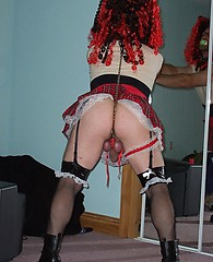Kinky crossdressing sluts bend over and show their thong covered asses