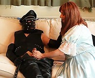 Hot tranny maid Luci May laps up her masked masters cock ready for a sticky surprise